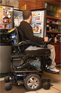 Kiel getting food from the refrigerator.
