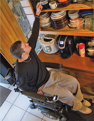 Kiel reaching a high shelf.