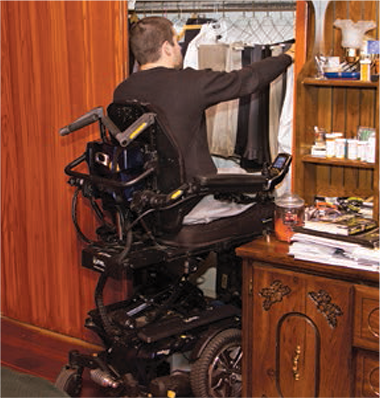 Kiel gets clothes from the closet.