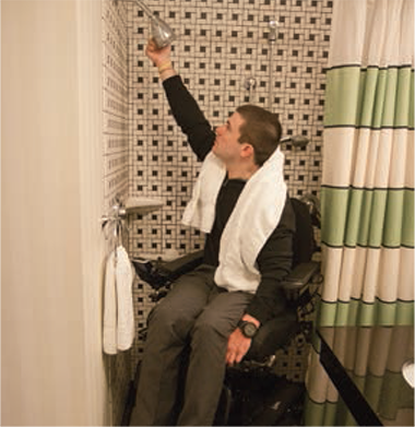 Kiel gets the shower ready.