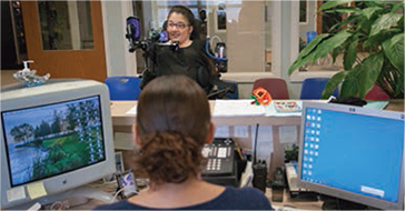 Zoe speaks to a receptionist