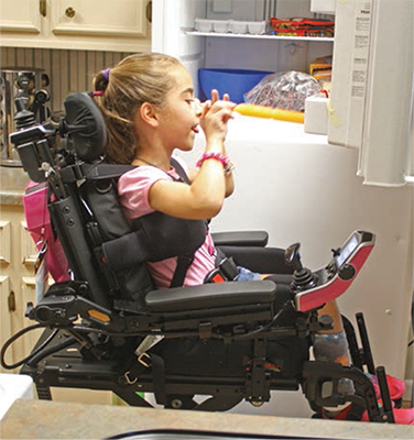 Girl reaches freezer