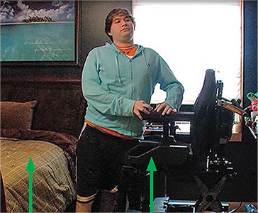Josh stands with his hips and knees hyperextended to 'lock' the joints.
