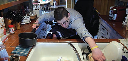 Kiel using the sink.