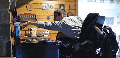 Kiel using the stove.